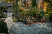 This bluestone and brick walkway leads effortlessly onto a generous patio as well as the main entrance.
