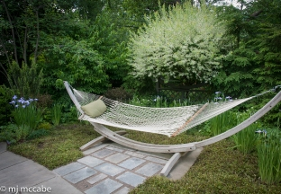 Furniture that shares an affinity with the surrounding garden site creates a kinship that is welcoming and inviting.