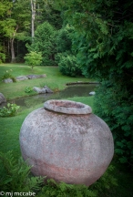 An antique weathered pot is a beautiful focal point in this garden—instilling reflection and even a sense of melancholy.